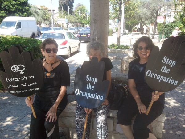 Women in black against occupation